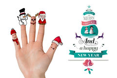 Composite image of christmas caroler fingers Royalty Free Stock Image
