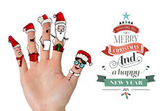 Composite image of christmas caroler fingers Stock Images