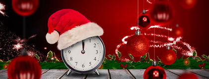 Composite image of christmas clock Stock Photo