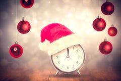 Composite image of christmas clock Stock Photo