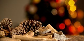 Composite image of christmas decorations on wooden table stock image