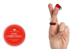 Composite image of christmas fingers. Christmas fingers against banner and logo saying merry christmas Stock Image