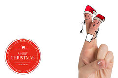Composite image of christmas fingers. Christmas fingers against banner and logo saying merry christmas Stock Images