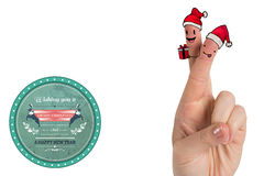 Composite image of christmas fingers. Christmas fingers against banner wishing a merry christmas Royalty Free Stock Image
