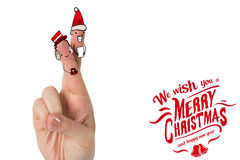 Composite image of christmas fingers. Christmas fingers against christmas greeting Stock Photos
