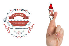 Composite image of christmas fingers. Christmas fingers against christmas greetings Stock Photo