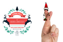 Composite image of christmas fingers. Christmas fingers against christmas greetings Stock Photos