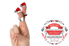 Composite image of christmas fingers. Christmas fingers against christmas greetings Royalty Free Stock Photos