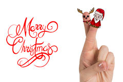 Composite image of christmas fingers. Christmas fingers against merry christmas message Stock Image