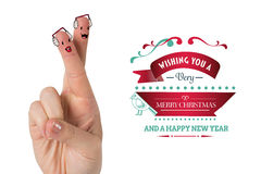 Composite image of christmas fingers. Christmas fingers against merry christmas message Stock Photos