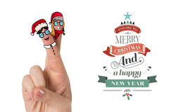 Composite image of christmas fingers. Christmas fingers against merry christmas message Royalty Free Stock Photography
