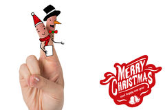 Composite image of christmas fingers. Christmas fingers against merry christmas message Stock Photography