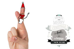 Composite image of christmas fingers. Christmas fingers against christmas message Stock Photography