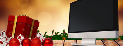 Composite image of christmas gifts Stock Photo