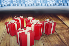 Composite image of christmas gifts Stock Image