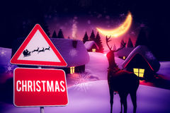 Composite image of christmas road sign Royalty Free Stock Image