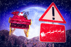 Composite image of christmas road sign Stock Photo
