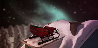 Composite image of christmas sledge with bells Stock Image