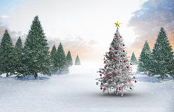 Composite image of christmas tree with baubles and star Royalty Free Stock Image