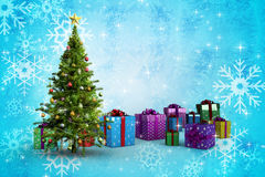 Composite image of christmas tree and presents Stock Images