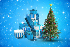 Composite image of christmas tree and presents Stock Photo