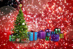 Composite image of christmas tree and presents Stock Photography