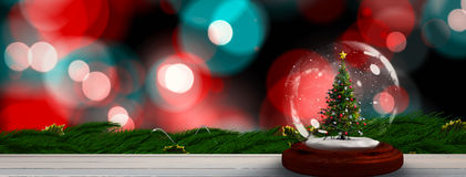 Composite image of christmas tree in snow globe Royalty Free Stock Images