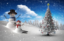 Composite image of christmas tree and snowman Royalty Free Stock Image