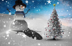 Composite image of christmas tree and snowman Stock Photos