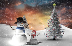 Composite image of christmas tree and snowman. Against fir tree in snowy landscape Royalty Free Stock Photos