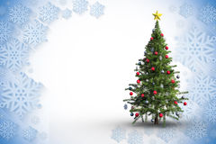 Composite image of christmas tree on white background. Christmas tree on white background against blue and white snowflake design Stock Photography