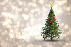 Composite image of christmas tree on white background. Christmas tree on white background against light glowing dots design pattern Stock Photo