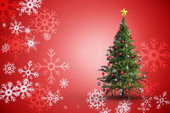 Composite image of christmas tree on white background. Christmas tree on white background against red snow flake pattern design Royalty Free Stock Photo