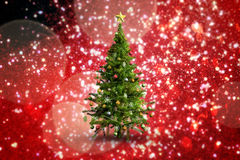 Composite image of christmas tree on white background. Christmas tree on white background against white snow and stars on red Stock Photography