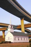 Composite image of a church amid freeway overpasses Stock Photography