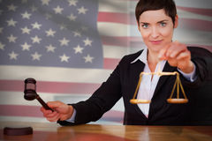 Composite image of close-up of american flag. Close-up of American flag against portrait of judge with  gavel and justice scale Royalty Free Stock Photo