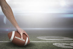 Composite image of close-up of american football player placing the ball 3D Royalty Free Stock Photo