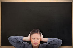 Composite image of close up of annoyed tradeswoman covering her ears Stock Image