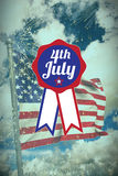 Composite image of close up of badge with 4th july text. Close up of badge with 4th July text  against colourful fireworks exploding on black background Vector Illustration