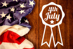 Composite image of close up of badge with 4th july text Royalty Free Stock Photography
