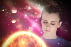 Composite image of close up of beautiful woman meditating 3d Stock Photo