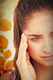 Composite image of close-up of beautiful woman suffering from headache Stock Images