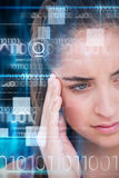 Composite image of close-up of beautiful woman suffering from headache Stock Photography