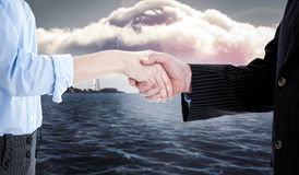 Composite image of close up of a business people closing a deal Royalty Free Stock Photography