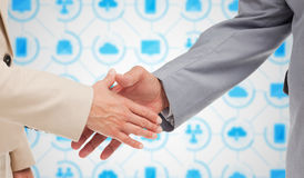 Composite image of close up of business people shaking their hands Royalty Free Stock Images