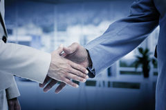 Composite image of close up of business people shaking their hands Stock Photography