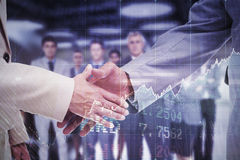 Composite image of close up of business people shaking their hands Royalty Free Stock Image