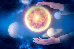 Composite image of close-up of businessman hands gesturing 3d. Close-up of businessman hands gesturing against graphic image of various planets 3d Stock Photo