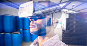 Composite image of close up of businessman holding virtual glasses Royalty Free Stock Image
