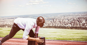 Composite image of close up of businessman in starting blocks stock photos